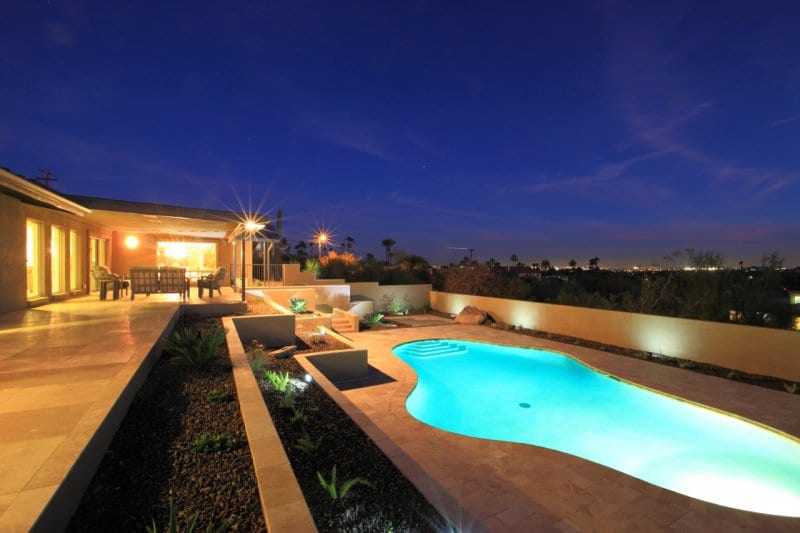 back-yard-with-pool-after-night-time